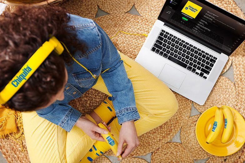 Chiquita's new playlists on Spotify - women with computer
